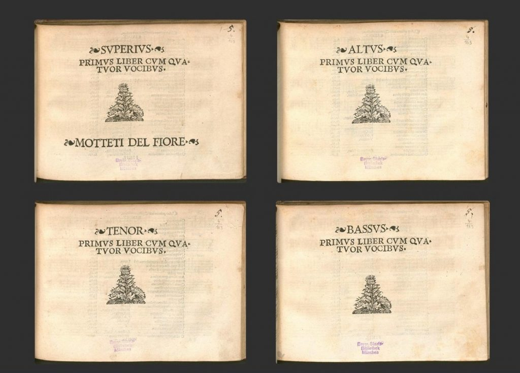 title pages of the 4 partbooks , primus liber cum quatuor vocibus. There is an image of a flowering plant on the center of the cover.